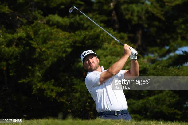 Graeme McDowell of Northern Ireland plays his shot from the 11th tee during the second round of the ATT Pebble Beach ProAm at Monterey Peninsula...