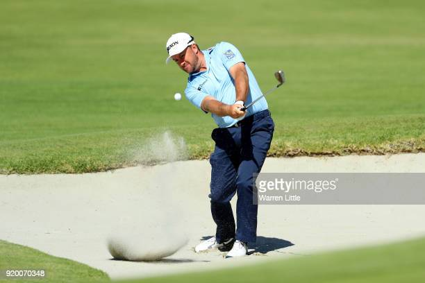 Graeme McDowell of Northern Ireland plays his shot from the bunker on the 10th hole during the final round of the Genesis Open at Riviera Country...