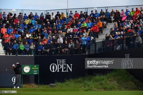 Graeme McDowell of Northern Ireland plays his shot from the first tee during the first round of the 148th Open Championship held on the Dunluce Links...