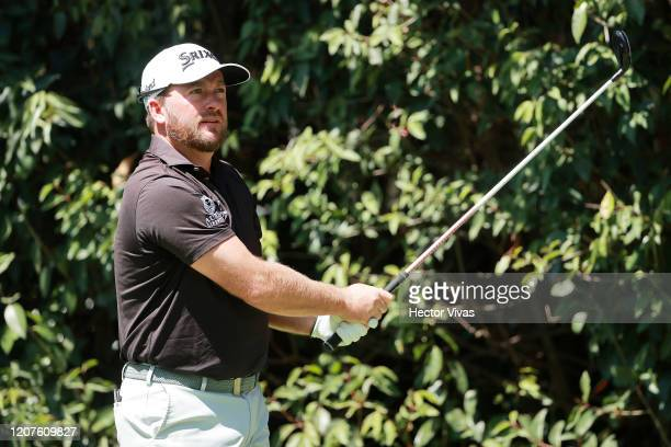 Graeme McDowell of Northern Ireland plays his shot from the second tee during the first round of the World Golf Championships Mexico Championship at...