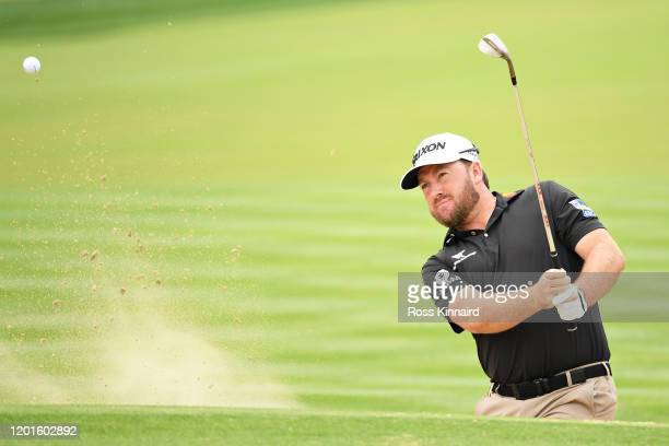 Graeme McDowell of Northern Ireland plays his third shot on the sixth hole during Day Two of the Omega Dubai Desert Classic at Emirates Golf Club on...