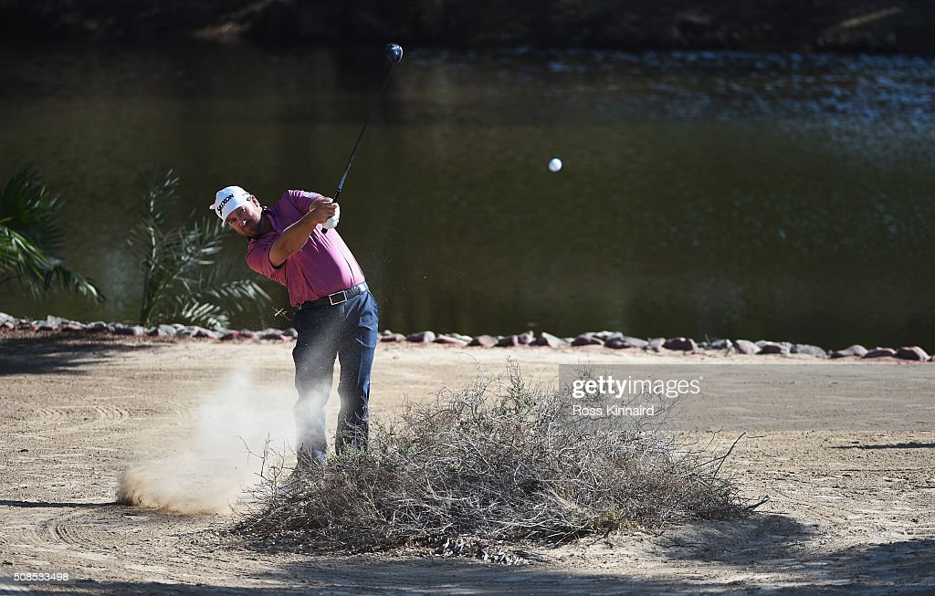 Graeme McDowell of Northern Ireland plays out of trouble on the 12th hole during the second round of the Omega Dubai Desert Classic at the Emirates Golf Club on February 5, 2016 in Dubai, United Arab Emirates.