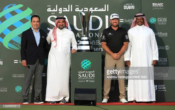 Graeme McDowell of Northern Ireland poses for a photograph with the trophy alongside His Excellency Yasir AlRumayyan Chairman Saudi Golf Federation...