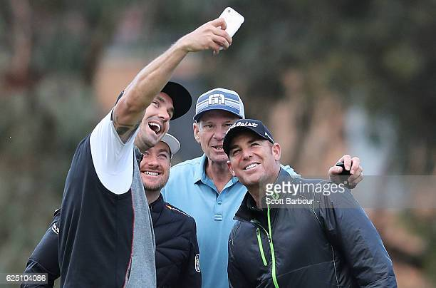 Graeme McDowell of Northern Ireland poses for a selfie photo with former cricketers Kevin Pietersen and Shane Warne and former AFL player Sam Newman...