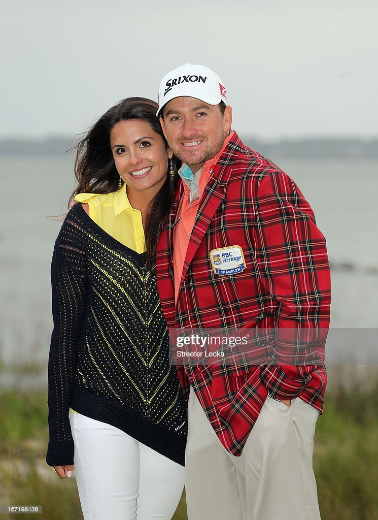 Graeme McDowell of Northern Ireland poses with his fiance Kristin Stern after defeating Webb Simpson in a playoff during the final round of the RBC Heritage at Harbour Town Golf Links on April 21, 2013 in Hilton Head Island, South Carolina.