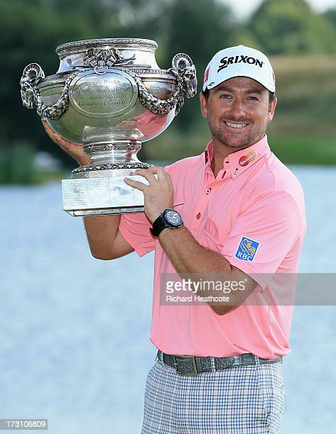 Graeme McDowell of Northern Ireland poses with the trophy after victory in the final round of the Alstom Open de France at Le Golf National on July 7...