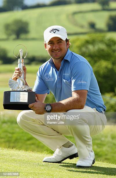 Graeme McDowell of Northern Ireland poses with the trophy after winning the Celtic Manor Wales Open on The Twenty Ten Course on June 6 2010 in...