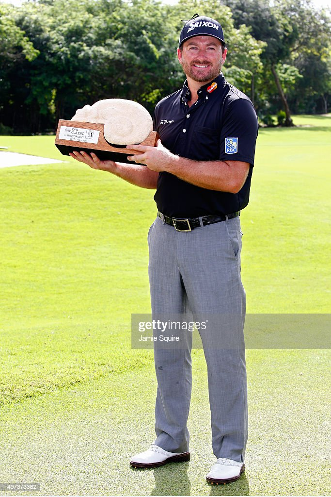 Graeme McDowell of Northern Ireland poses with the trophy after winning the three man playoff in the final round of the OHL Classic at the Mayakoba El Camaleon Golf Club on November 16, 2015 in Playa del Carmen, Mexico.
