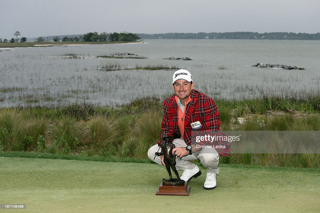 Graeme McDowell of Northern Ireland poses with the trophy after defeating Webb Simpson in a playoff during the final round of the RBC Heritage at Harbour Town Golf Links on April 21, 2013 in Hilton Head Island, South Carolina.