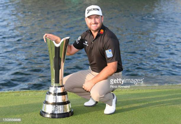 Graeme McDowell of Northern Ireland poses with the trophy during Day 4 of the Saudi International at Royal Greens Golf and Country Club on February...