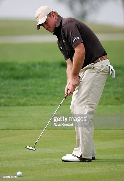 Graeme McDowell of Northern Ireland putting on the par four 12th hole during the final round of the Volvo China Open at the Shanghai Silport Golf...