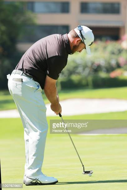 Graeme McDowell of Northern Ireland putts on the first green during the first round of the World Golf Championships Mexico Championship at Club de...