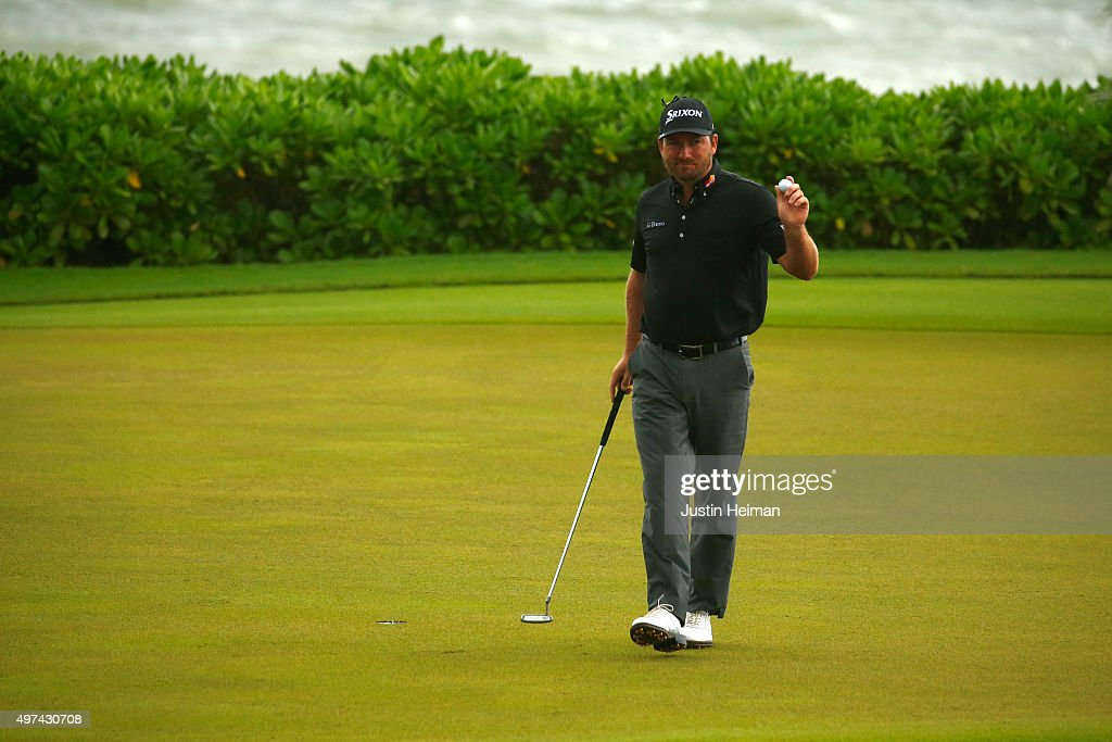Graeme McDowell of Northern Ireland reacts after putting on the 15th hole during the final round of the OHL Classic at the Mayakoba El Camaleon Golf Club on November 16, 2015 in Playa del Carmen, Mexico.