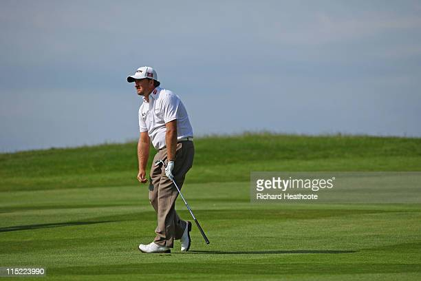 Graeme McDowell of Northern Ireland reacts to his approach to the 18th green during the third round of the Saab Wales Open on the Twenty Ten course...