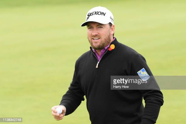 Graeme McDowell of Northern Ireland reacts to his birdie on the 14th green during the second round of the ATT Pebble Beach ProAm at Monterey...