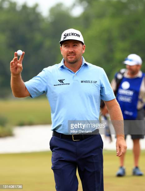 Graeme McDowell of Northern Ireland reacts to his hole in one on the 17th green during the second round of the Zurich Classic of New Orleans at TPC...