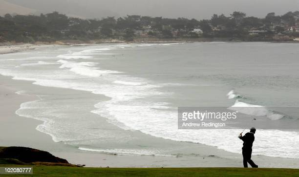 Graeme McDowell of Northern Ireland watches a shot during a practice round prior to the start of the 110th US Open at Pebble Beach Golf Links on June...