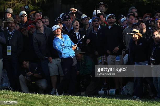 Graeme McDowell of Northern Ireland watches a shot shot on the 15th hole during the third round of the 110th US Open at Pebble Beach Golf Links on...