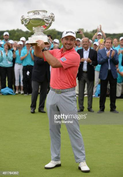 Graeme McDowell of Northern Ireland with the trophy after winning the Alstom Open de France Day Four at Le Golf National on July 6 2014 in Paris...