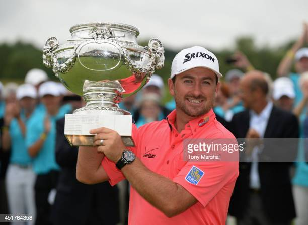 Graeme McDowell of Northern Ireland with the trophy after winning the Alstom Open de France - Day Four at Le Golf National on July 6, 2014 in Paris,...