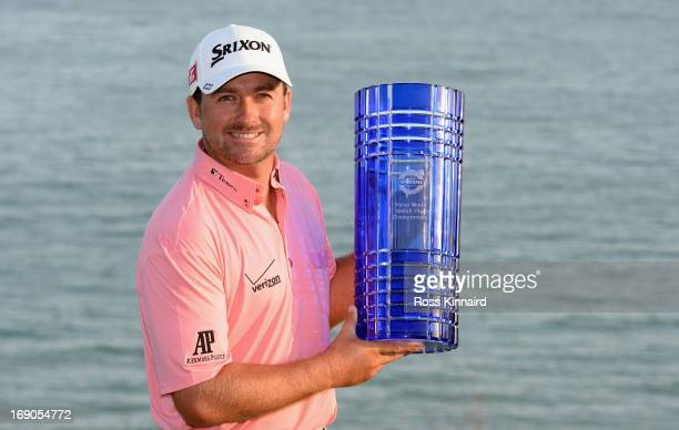 Graeme McDowell of Northern Ireland with the winners trophy after the final of the Volvo World Match Play Championship at Thracian Cliffs Golf &...