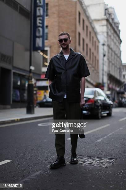 Graeme Moran is seen wearing a Black Leather Shirt at Richard Quinn, during London Fashion Week September 2021 on September 21, 2021 in London,...
