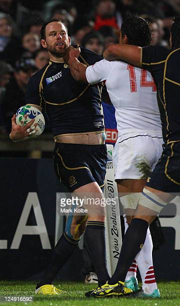 Graeme Morrison of Scotland exchanges words with Irakli Machkhaneli of Georgia during the IRB 2011 Rugby World Cup Pool B match between Scotland and...