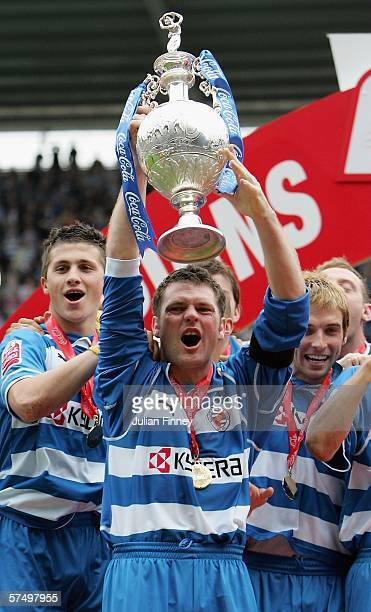 Graeme Murty of Reading celebrates winning the Championship League with a record points scored by lifting the trophy after the CocaCola Championship...