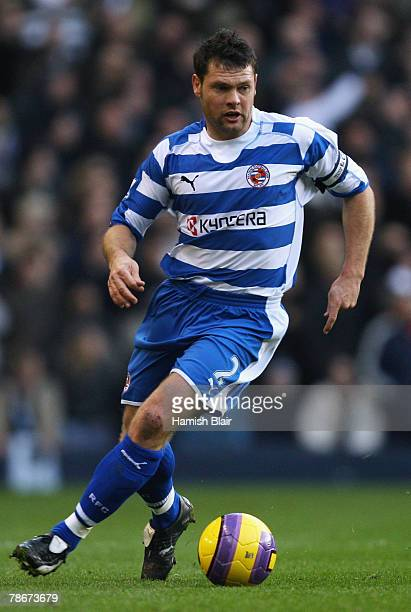 Graeme Murty of Reading runs with the ball during the Barclays Premier League match between Tottenham Hotspur and Reading at White Hart Lane on...