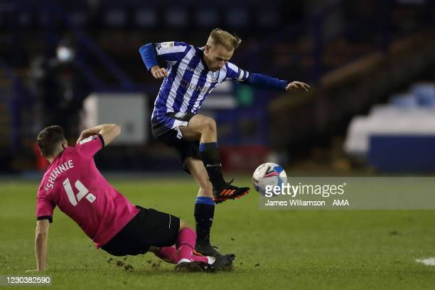 Graeme Shinnie of Derby County and Barry Bannan of Sheffield Wednesday during the Sky Bet Championship match between Sheffield Wednesday and Derby...