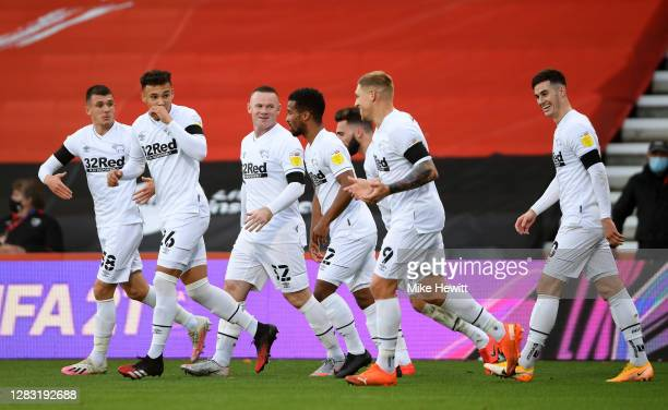 Graeme Shinnie of Derby County celebrates with his team after he scores his sides first goal during the Sky Bet Championship match between AFC...