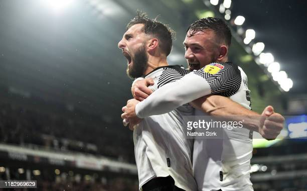 Graeme Shinnie of Derby County celebrates with Jack Marriott after he scores the first goal during the Sky Bet Championship match between Derby...