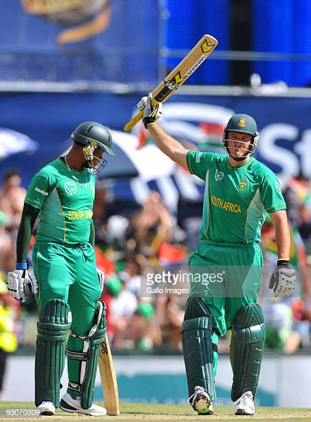 Graeme Smith captain of South Africa celebrates reaching his 50 with team mate Loots Bosman during the 2nd Twenty20 international match between South...