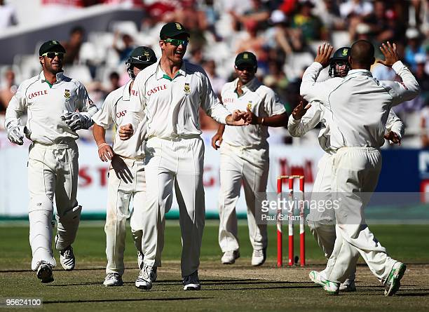 Graeme Smith of South Africa and his teammates celebrate JeanPaul Duminy taking the wicket of Paul Collingwood of England for 40 runs when he was...