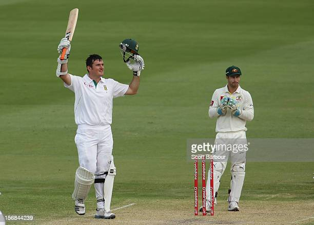 Graeme Smith of South Africa celebrates as he reaches his century as Matthew Wade of Australia looks on during day two of the Second Test match...