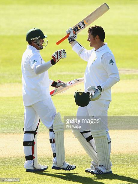Graeme Smith of South Africa celebrates his century with Jacques Kallis during day three of the First Test match between New Zealand and South Africa...