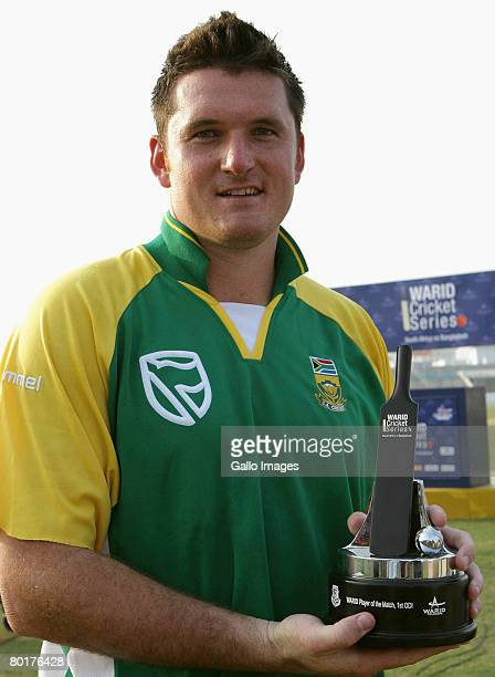 Graeme Smith of South Africa celebrates with his man of the match award after scoring 103 runs during the 1st One Day International match between...