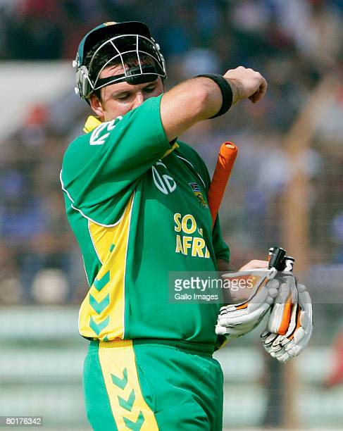 Graeme Smith of South Africa feels the heat on his way to scoring 50 runs during the 1st One Day International match between Bangladesh and South...