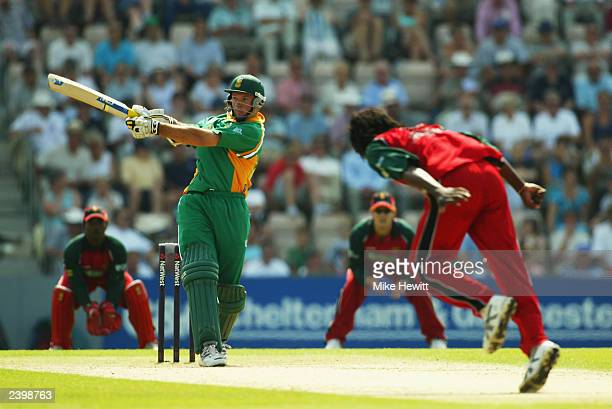 Graeme Smith of South Africa hits out on his way to making fifty during the ninth match of the NatWest One Day Triangular Series between Zimbabwe and...