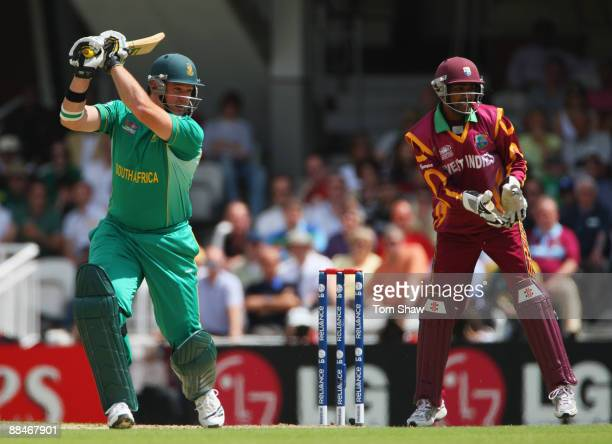 Graeme Smith of South Africa hits out watched by Denesh Ramdin of West Indies during the ICC World Twenty20 Super Eights match between South Africa...
