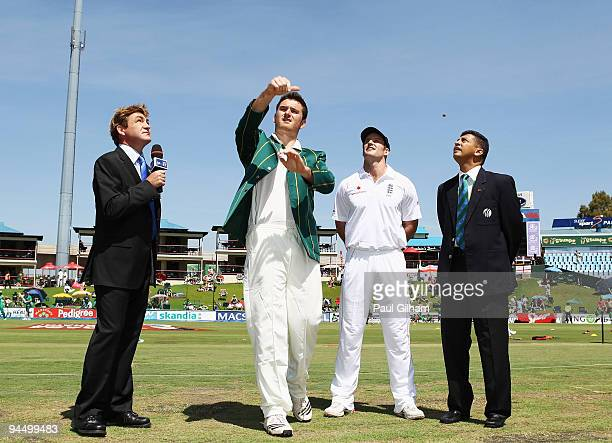 Graeme Smith of South Africa makes the toss which England captain Andrew Strauss wins and elects to bowl during day one of the first test match...