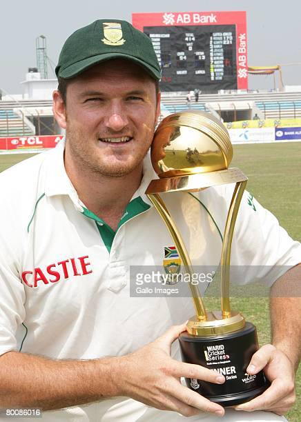 Graeme Smith of South Africa poses with the Series Trophy during day four of the second test match between Bangladesh and South Africa held at the...