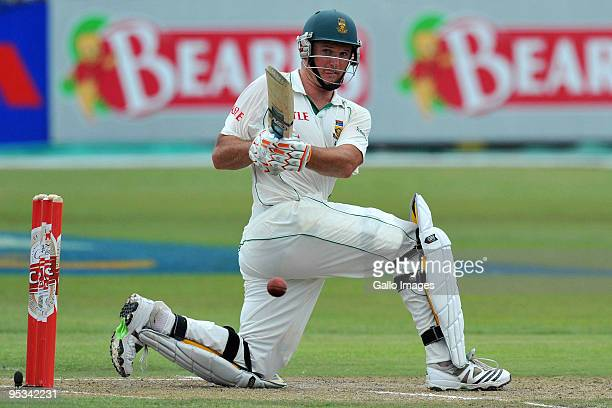 Graeme Smith of South Africa sweeps a delivery from Graeme Swann of England during day 1 of the 2nd test match between South Africa and England from...
