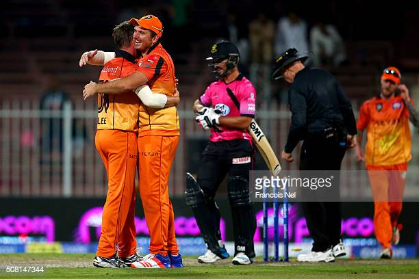 Graeme Smith of Virgo Super Kings and Brett Lee of Virgo Super Kings celebrate winning the Oxigen Masters Champions League match between Libra...