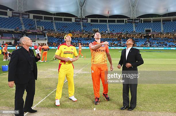 Graeme Smith of Virgo Super Kings tosses the coin with Adam Gilchrist of Sagittarius Strikers prior to the Oxigen Masters Champions League 2016 match...