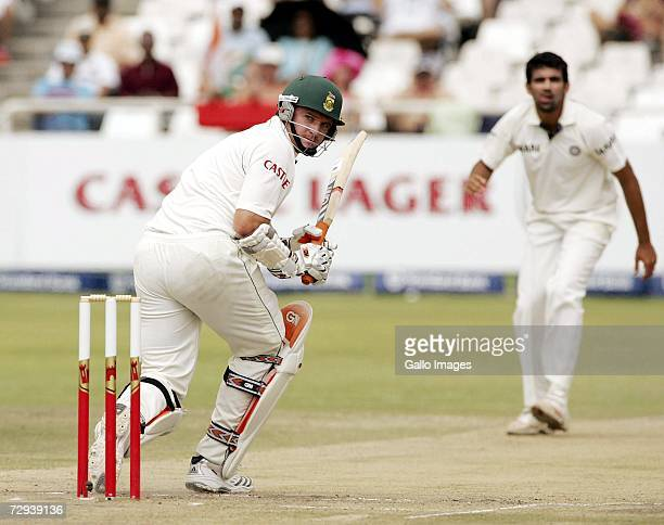 Graeme Smith plays a shot off a delivery by Zaheer Khan during day 5 of the Third test between South Africa and India at the Sahara Park Newlands...