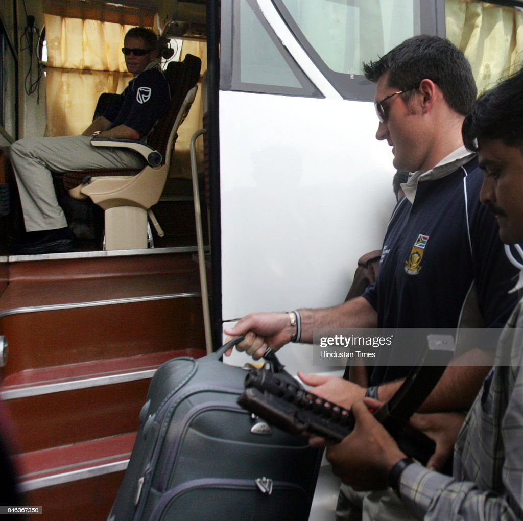 Graeme Smith, South African cricket team captain and Shaun Pollock arrive at Mumbai domestic airport.