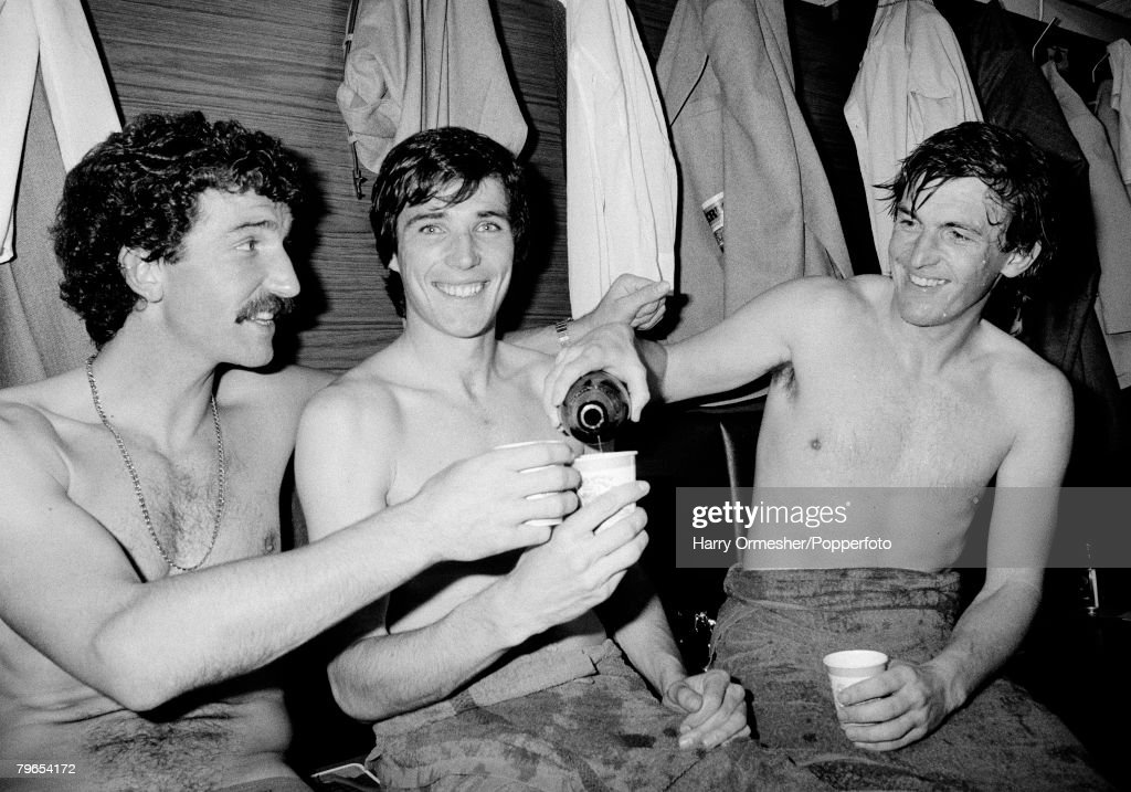 7th May 1983, Anfield, Liverpool, Liverpool 1 v Aston Villa 1, Liverpool players Graeme Souness, Alan Hansen and Kenny Dalglish celebrate their championship win by drinking champagne : News Photo