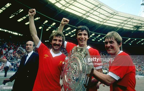 Graeme Souness Alan Hansen and Kenny Dalglish of Liverpool hold the trophy after the Charity Shield match against Arsenal at Wembley Stadium in...