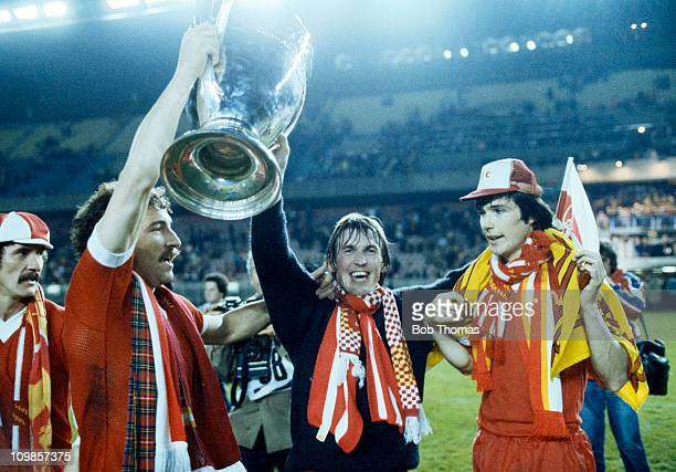 Graeme Souness Kenny Dalglish and Alan Hansen celebrate with the European Cup after Liverpool had beaten Real Madrid 10 in the European Cup Final at...